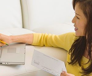a woman pointing at a laptop