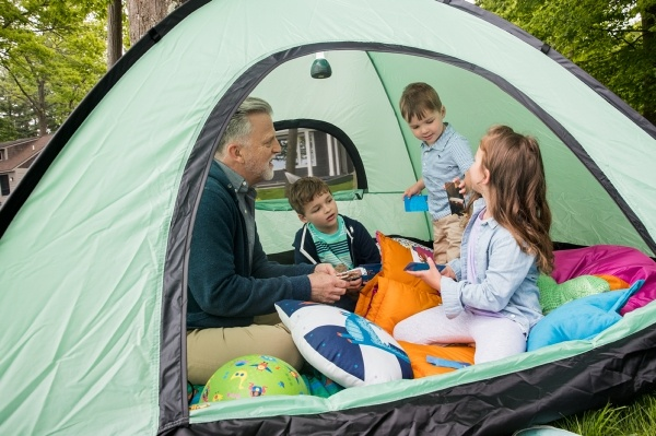 father in a tent with his kids