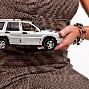 Holding a car.