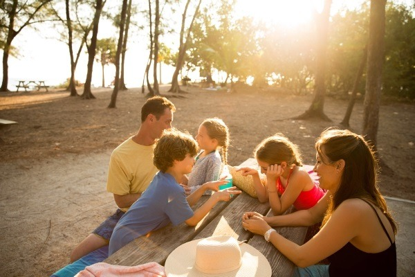 family picnicking at the beach