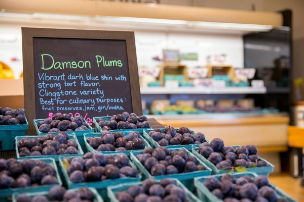 Plums on display in grocery store