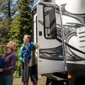 a couple getting out of an RV