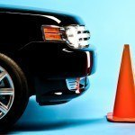Car and traffic cone.