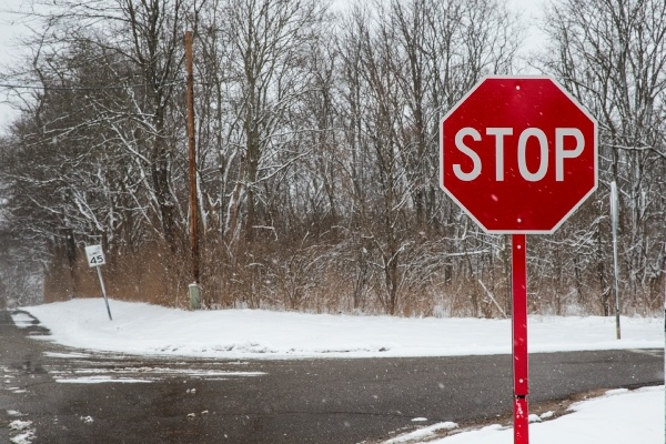 icy road with a red stop sign