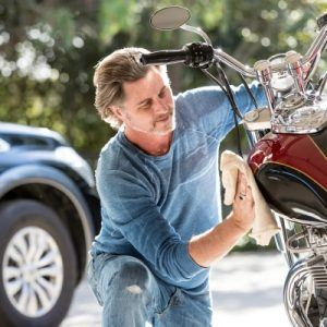 man working on his motorcycle