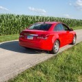 red car on road in field