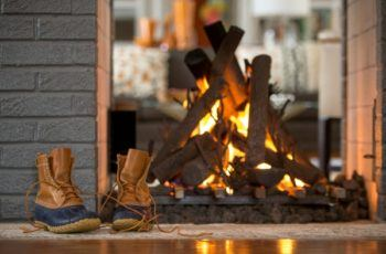 fire in fireplace with boots on hearth