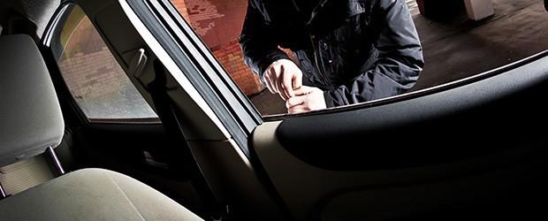 a person lock picking a car