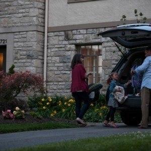 family unloading car