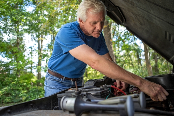 Man performing DIY car maintenance