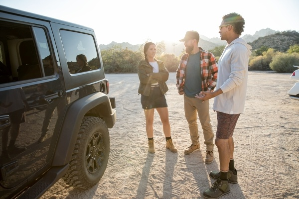 people standing near a jeep
