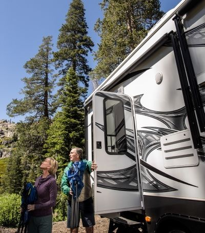 Couple exiting RV