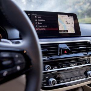 Close up of car dashboard with navigation screen