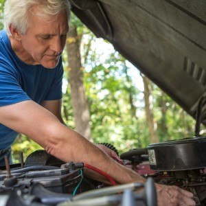Man cleaning car engine