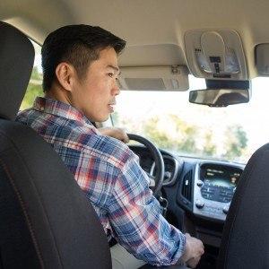 Man test driving car