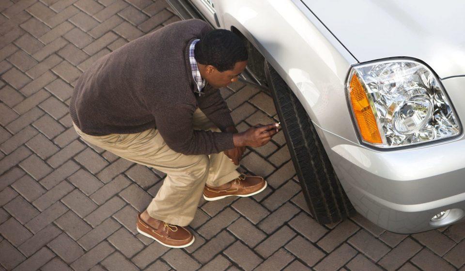 Man checking tire pressure