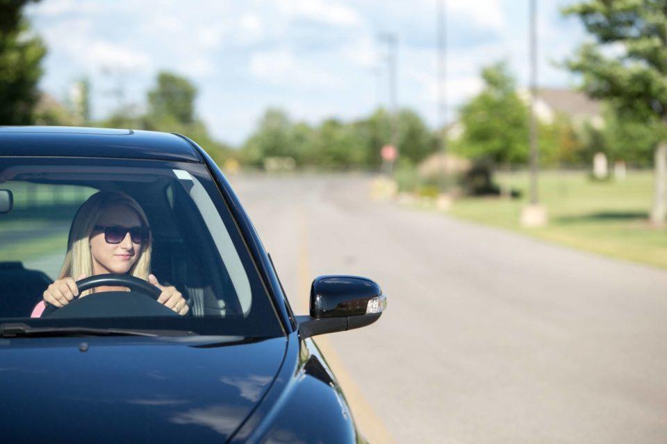 Woman driving durable car