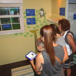 Visitors to The Great New York State Fair learn about cord and blind safety – just one of the interactive stations inside the Make Safe Happen Safety Experience.