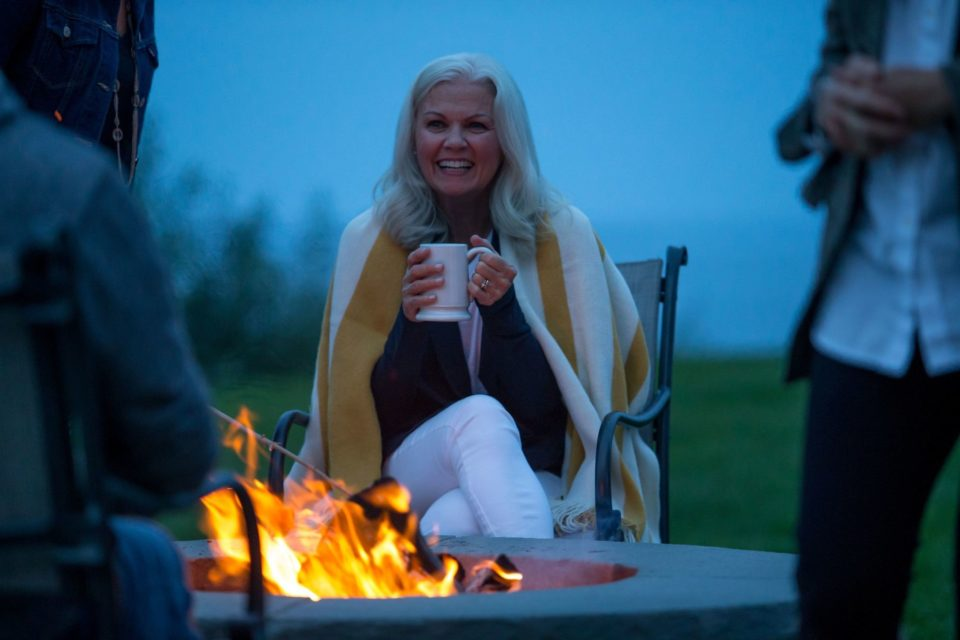Woman by fire pit