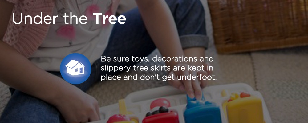 a child playing with a toy with text 'under the tree'