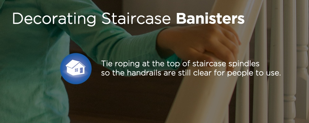 hand holding a handrail with text 'decorating staircase banisters'