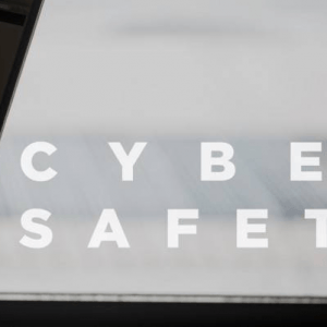a laptop with text 'cyber safety'