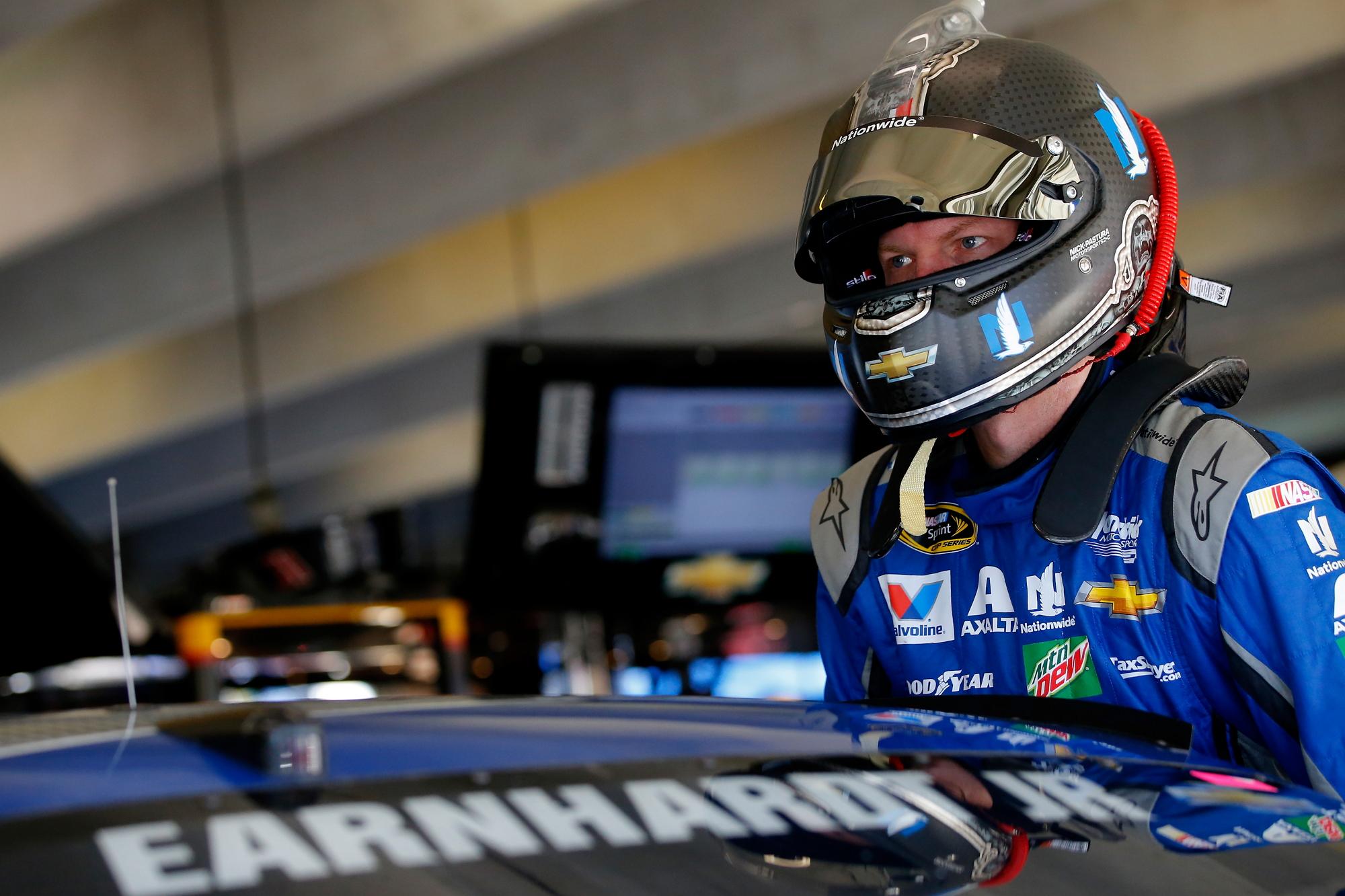 a NASCAR driver with a helmet
