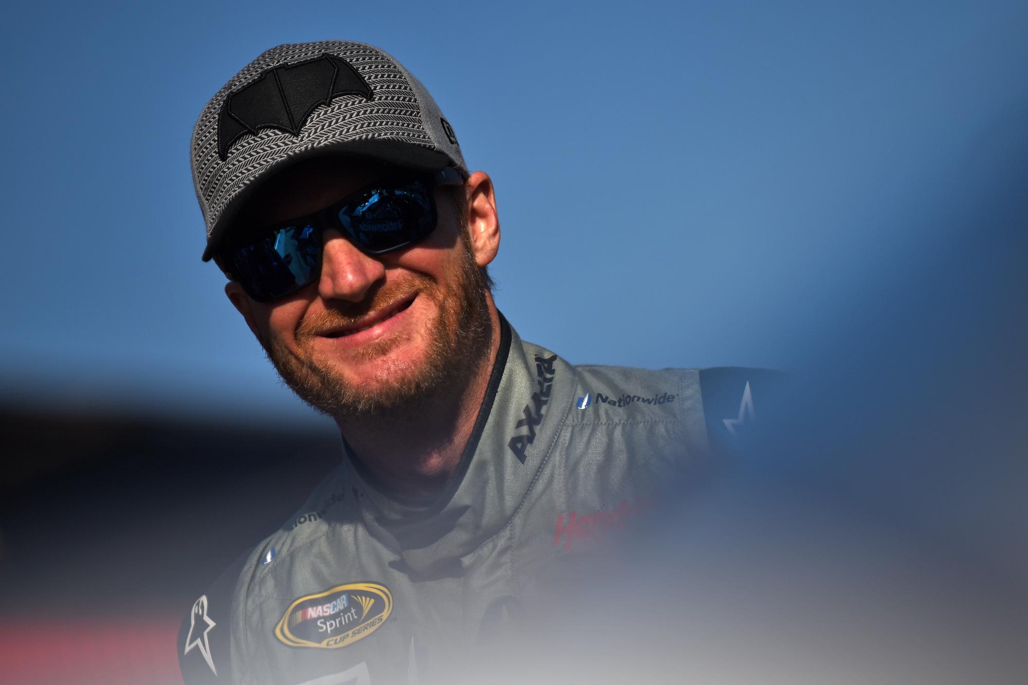 a smiling NASCAR driver