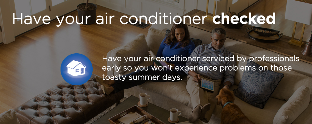 "a couple sitting in the living room with text ""have your air conditioner checked"""
