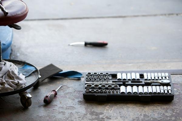 tools on a garage floor