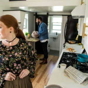 woman and man in small kitchen