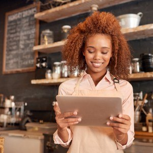 a barista holding a tablet