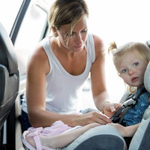 woman with baby in car seat
