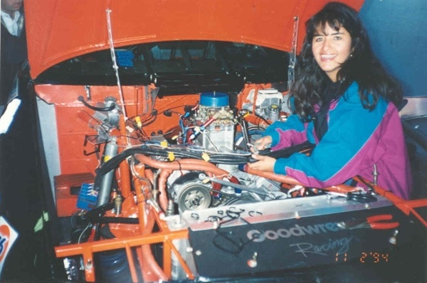a woman with a car engine