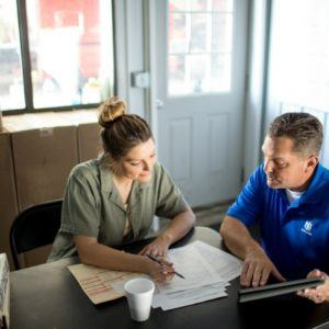 two people reviewing a plan