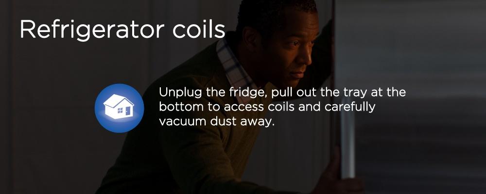 a man looking in a fridge