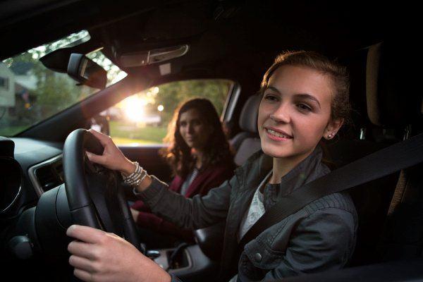 teenage girl driving car