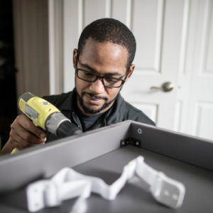 a man using a screwdriver
