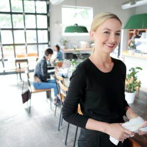 Woman smiling in restaurant