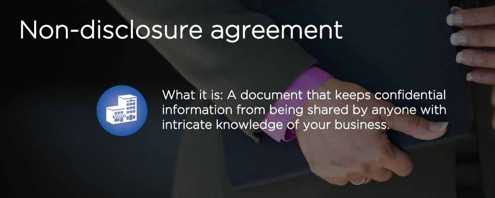a person wearing a suit with text 'non-disclosure agreement'