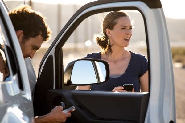 Couple figuring out what to do after a car accident
