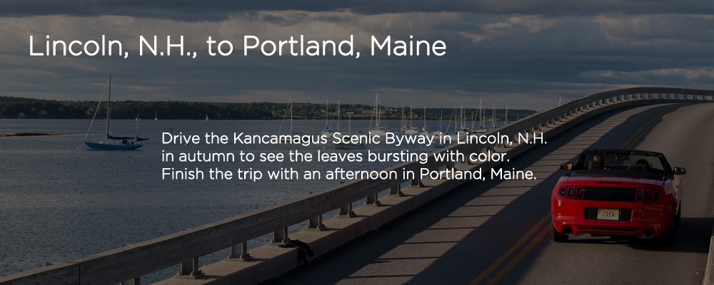 a car driving on a road with text 'Lincoln, NH to Portland, Maine'