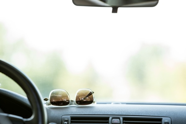 sunglasses on car dashboard