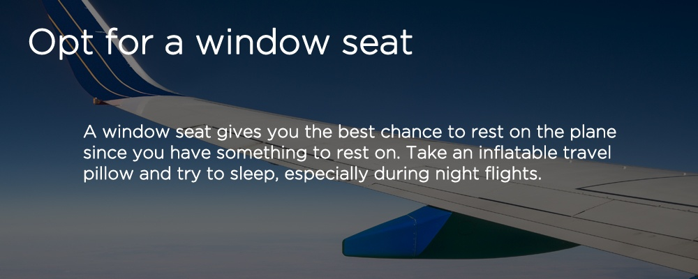 a wing of an airplane with text 'opt for a window seat'