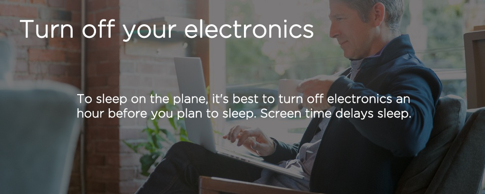 a man on a laptop with text 'turn of your electronics'