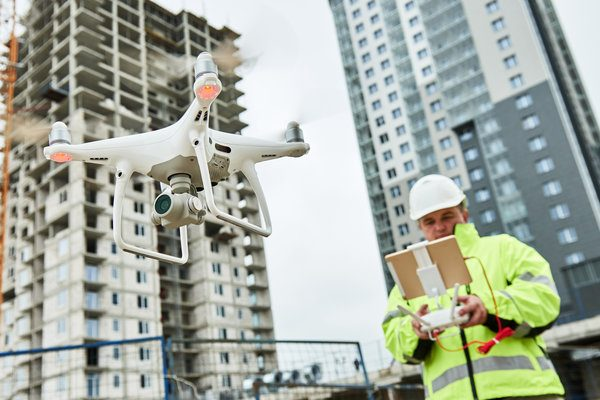 a man operating a flying drone