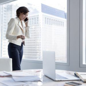 woman in office talking on cell phone