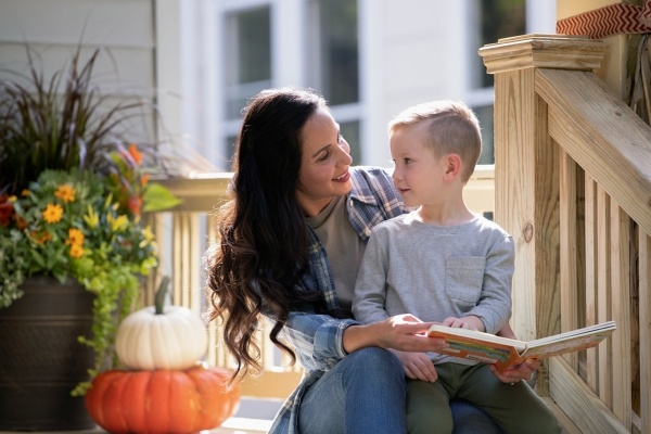 woman sitting on porch with her son