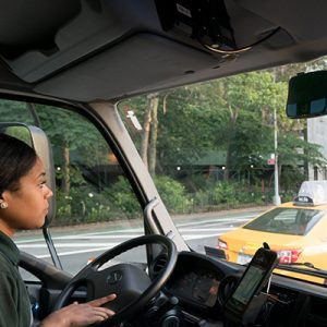 woman driving in city traffic