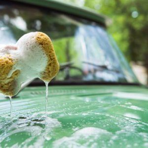washing a green car
